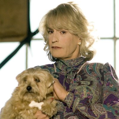 Rupert Everett with Dolly the Norfolk Terrier filming St Trinians